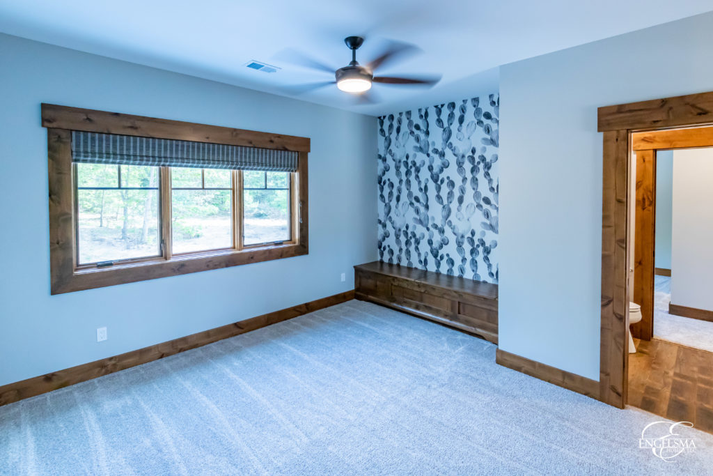beautiful designed room with oversized window and wallpapered wall
